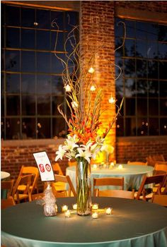 Centerpiece Featuring Suspended Candles, Curly Willow, Gladiolus and Lilies