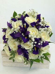 Blue iris and Avalanche rose bridal bouquet