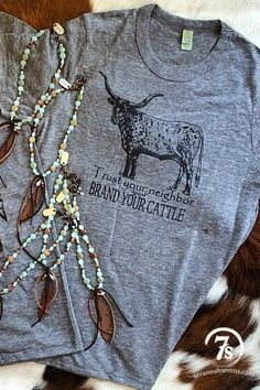 """The Brand Your Cattle – """"Trust your neighbor but brand your cattle"""" t-shirt from Savannah Sevens Western Chic"""