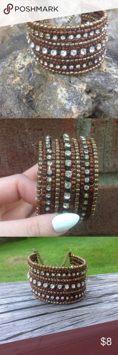 Fun bracelet! Beaded bracelet with rhinestones. Beads are brown and brass!  Chain claw closure. Jewelry Bracelets