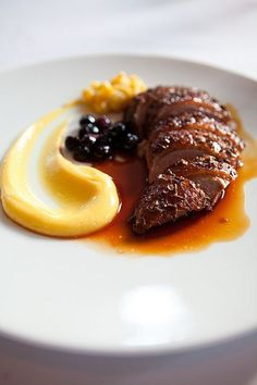Duck Eleven Madison Park is part of food_drink - Duck roasted with lavender honey, sweet corn, and blueberries Duck Recipes, Gourmet Recipes, Cooking Recipes, Gourmet Desserts, Plated Desserts, Gourmet Food Plating, Gourmet Appetizers, Gourmet Meals, Gourmet Popcorn