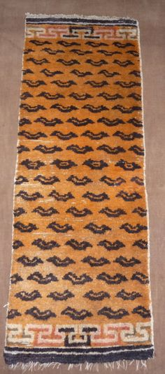Small tiger rug, not a Tibetan weaving, was intended to be hung in a doorway or as a pillar decoration for a Tibetan monastery. Despite its late 19th or early 20th century age, this is today a rare object, China, Qinghai
