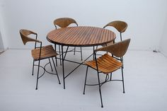 Mid Century Vintage Modern Arthur Umanoff Table Chair Patio Set for Raymor. $1,100.00, via Etsy.