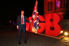 Andy Murray Photos - Flag bearer Andy Murray poses outside the Team GB British House during the Team GB British House Reception ahead of the Rio 2016 Olympic Games on August 3, 2016 in Rio de Janeiro, Brazil. - Team GB - British House Reception & Flagbearer Photocall