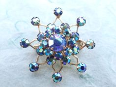 Vintage Star brooch with iridescent blue rhinestones AB945 by MeyankeeGliterz on Etsy