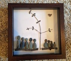 A family and their grandbabies. Pebble art by www.saltandpebbles.com