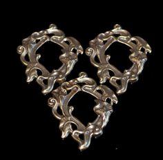 3 brass filigree lillies by themetalworx on Etsy, $1.75
