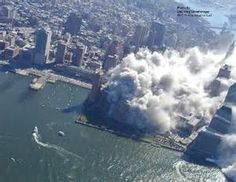 After the North Tower collapses, the dust and debris cloud spreads.