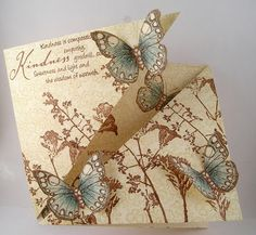 handcrafted card from Suzz's Stamping Spot ... triangle fold format partially open ... lu the warm brows with a touch of gray blue ... trio of butterflies with uplifted wings ...