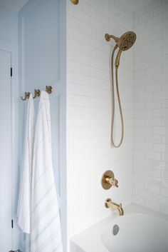 french bistro bathroom, bathroom renovation, light blue bathroom, white subway tile, gold shower fix Bronze Bathroom, Modern Bathroom, Master Bathrooms, Dream Bathrooms, Master Baths, Luxury Bathrooms, Concrete Bathroom, White Bathrooms, Minimalist Bathroom