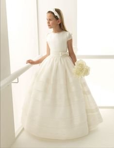 Find the perfect First Communion Dresses, First Holy Communion Dresses in Styletheaisle's Communion Dresses collection. The most beautiful designs of Dresses for First Communion and Girls Communion Dresses are NOW available. Holy Communion Dresses, First Holy Communion, Baptism Dress, Christening Gowns, Dress With Bow, White Dress, Communion Hairstyles, Girls Dresses, Flower Girl Dresses