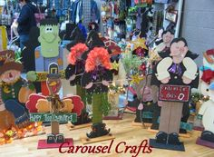 Fall Craft Show items.  Witch with Broom, Dracula, Turkey, Scarecrow sitting on pumpkin. Carousel Crafts Craft Show
