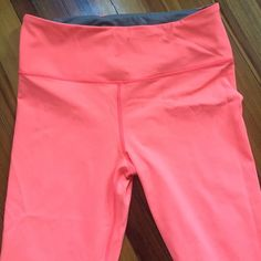 VSX knockout crop size medium VSX knockout crop, size medium. Orangey-coral color. Invisible drawstring waist inside. Perfect condition, worn only once. Smoke-free home! I think the color in the second photo is more accurate than the first - they are kind of a bright orangey pink Victoria's Secret Pants