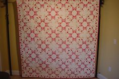 """Unusual SAWTOOTH FEATHERED STAR APPLIQUE. The size is 88"""" by 84"""" . This was an old cotton 1850 top that the makers family finished later in life. The back material is a whiter then the front."""