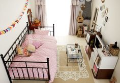 Small space with pink daybed and mini entertainment center