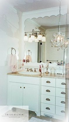 What a lovely girl's powder room! Whites, pinks, and soft, feminine features make this a dream powder room! I love the lighting as well, details make all the difference! Design: Trish Becher Interior Design // Cabinets: Generation Cabinets