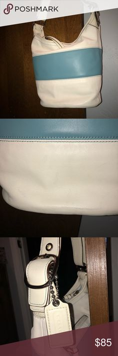 Coach Purse Shoulder Purse This shoulder Purse is in wonderful condition! The smallest scuff on the bottom side of the purse. (Picture 2)  when hanging on my shoulder, it hits right below my hip. This Coach Purse is ready for spring outfits! Coach Bags Shoulder Bags