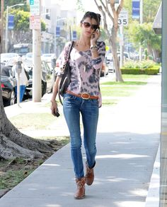 Alessandra Ambrosio worked a tie-dye top with skinny Citizens of Humanity jeans, studded cowboy boots, and a ton of gold baubles in Beverly Hills.