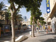 Photo taken in Sha`ar HaNamal st. looking up at HaNevieim Tower [the dark building ]  photo mirjam Bruck -Cohen