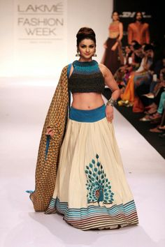 Lakme Fashion Week 2014 - Love the peacock in the white lehenga and the peacock feather dupatta