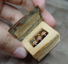 """11 cool things on a tuesday The old saying, """"good things come in small packages,"""" couldn't be truer when it comes to these cool leather-bound miniature books by Colorado artist Ericka VanHorn. Objet Harry Potter, Accessoires Barbie, Mini Craft, Miniature Crafts, Old Quotes, Handmade Books, Book Binding, Miniture Things, Book Making"""