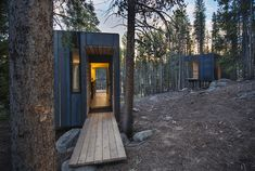 Small efficient cabins touch lightly on the land in the Colorado forest. Cabins are comprised of SIPS, hot rolled steel cladding, and wood finishes. By Colorado Building Workshop.