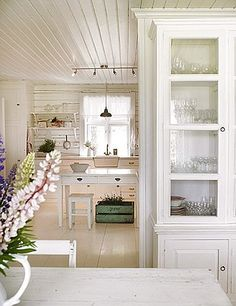 View into a simple cottage kitchen in Norway--and yes, I'm Norwegian, so that explains why I love this so much