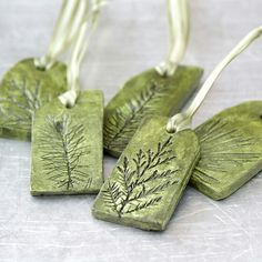 Ceramic Ornaments with Natural Plant Impression Christmas Holiday Decoration – Set of 5 —————————————————————————— I have hand-sculpted these nature inspired clay ornaments from white clay and impressed real evergreen plant twigs Ceramic Jewelry, Polymer Clay Jewelry, Clay Projects, Clay Crafts, Clay Christmas Decorations, Natural Christmas Ornaments, Silver Ornaments, Tree Decorations, Cerámica Ideas