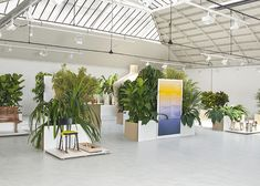 Plinths filled with tropical plants were designed by Swiss studio Big-Game, to showcase the finalists of a design competition in Paris organised by Hermès.