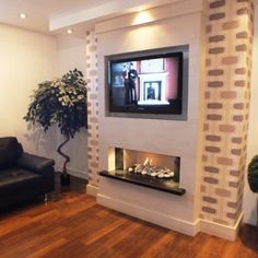 The Deluxe Wall fireplace in limestone with lights More