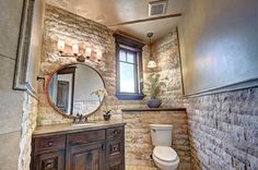 Now that\'s a #bathroom... By yours truly, #Habitations #Utah #Architect #Home #bathroo, #stone #window #woodvanity #Circlemirror