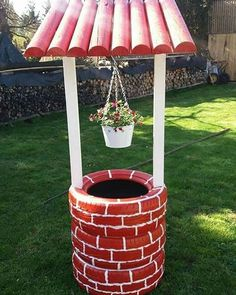 DIY GARDEN: re-purposing old tires so as to make a lovely yard decor - a charming little well that might shelter a flower clump. Tire Garden, Garden Yard Ideas, Diy Garden Projects, Diy Garden Decor, Garden Crafts, Garden Decorations, Holiday Decorations, Barrel Garden Ideas, Yard Art Crafts