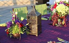 Beautifully exotic purple and green decor motif with a bronze lantern and floral arrangement #exotic #decor #lantern #wedding #outdoor