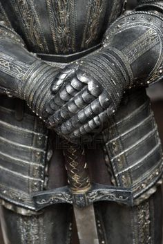 Detail of an old Renaissance armour with sword