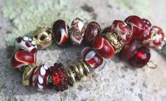 A little red inspiration for the Holiday season.  My Trollbeads bracelet in deep reds and gold.