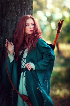 Beautiful red haired girl in green long medieval dress with bow and arrows standing near tree. Fairy tale story about brave heart woman . Fantasy Girl, Fantasy Inspiration, Character Inspiration, Fantasy Characters, Female Characters, Beautiful Redhead, Beautiful People, Elfa, Kim Jisoo
