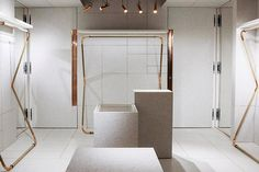 Maison Martin Margielas mm6 store, London UK fashion . a raw minimalist architecture, blending venetian marble resin and light birchwood with industrial copper.