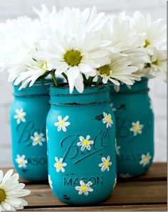painted and distressed mason jars in teal with hand painted daisies