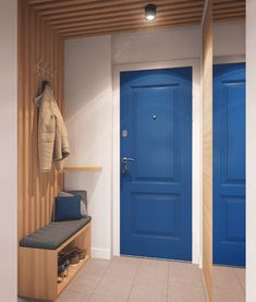Colorful and space savvy entry of Igralnaya designed by Geometrium Tiny Apartment Blends Space Savvy Design with Scandinavian Style Home Entrance Decor, House Entrance, Entryway Decor, Home Decor, Entry Hallway, Coat Hanger, Painted Doors, Apartment Design, Scandinavian Style