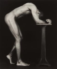 ROBERT MAPPLETHORPE  Thomas  1986  Gelatin silver print.  22 3/4 x 19 in. (57.8 x 48.3 cm)  Signed, titled, dated, numbered 6/10 in ink and copyright credit reproduction limitation stamp on the reverse of the flush-mount.