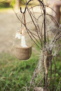 Taper candle in hanging mason jar with sand