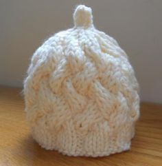 Free Pattern – Cable Weave Baby Hat · Knitting | CraftGossip.com