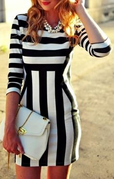 Black + white striped dress // the design lines are so flattering... WANT this now.