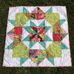 Scrappy Swoon Baby Quilt by Three Owls, via Flickr
