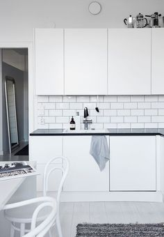 Sleek white kitchen and subway tiles in the Helsinki home of design blogger #lagerma, captured by Riika Kantikoski.