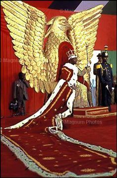 Emperor Bokassa at his Coronation.  Bokassa was dictator of the Central African Republic from 1976-1979.In 1979, children protested over being forced to buy costly school uniforms from one of Bokassa's wife's factories. In revenge, he had 180 children arrested. where he and the prison guards clubbed the children. He personally smashed five children 's skulls with his cane. He had himself crowned as emperor, and he spent one-third of the national budget on his initiation ceremony.