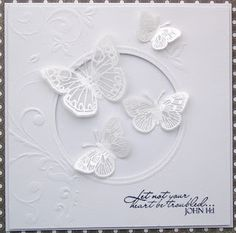 almost all white card with heat embossed white on vellum butterflies...beautiful card...