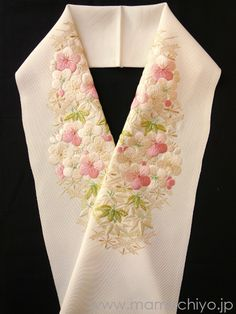 This is referred to as haneri in the scarf of the kimono.