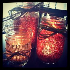 Could use mason jars or Dollar Tree vases, put glitter on them, tie on burlap or leaves, put corn or beans in the jar too or instead of candles.