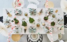 Picture from above of a table and chairs with party decorations
